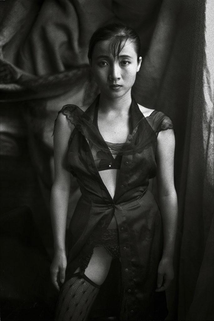 HU YUANLI BY THE WINDOW, GUANGZHOU, 1989